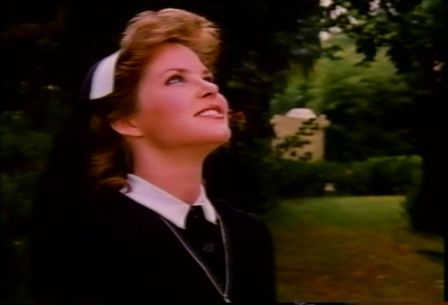 Melissa Sue Anderson as Elizabeth looking towards the heavens after seeing the miracle again